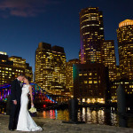 newlyweds in front of city skyline
