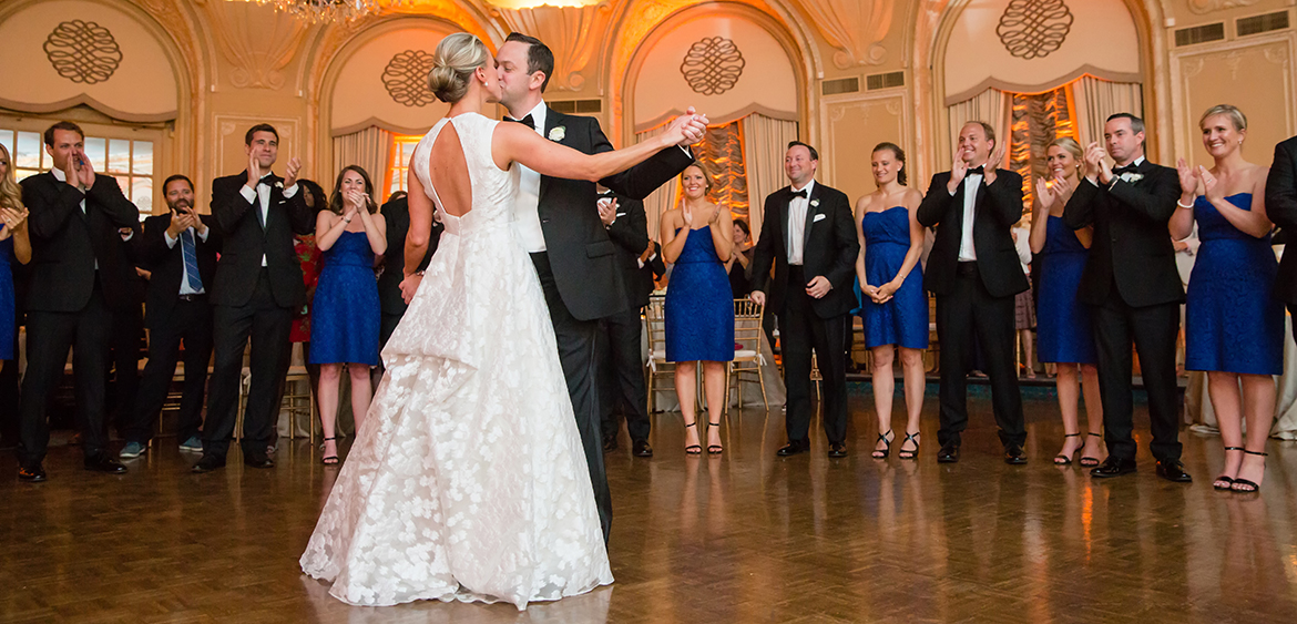 bride & groom dancing & kissing