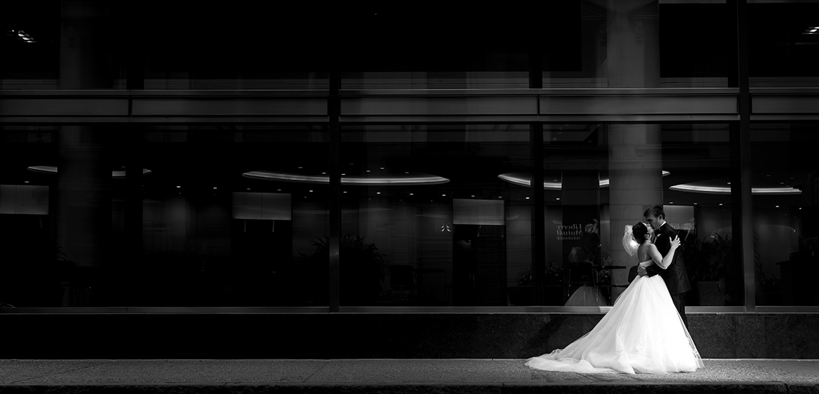 bride & groom kissing in Boston