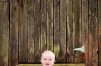 Baby Against Funky Shed Door