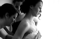 Bride Dressing by Window Light