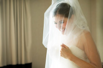 Bride While Dress is Buttoned